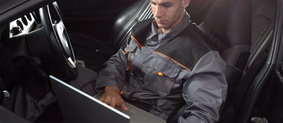 Mechanic checking a vehicle using a computer - ECU Remapping Bristol